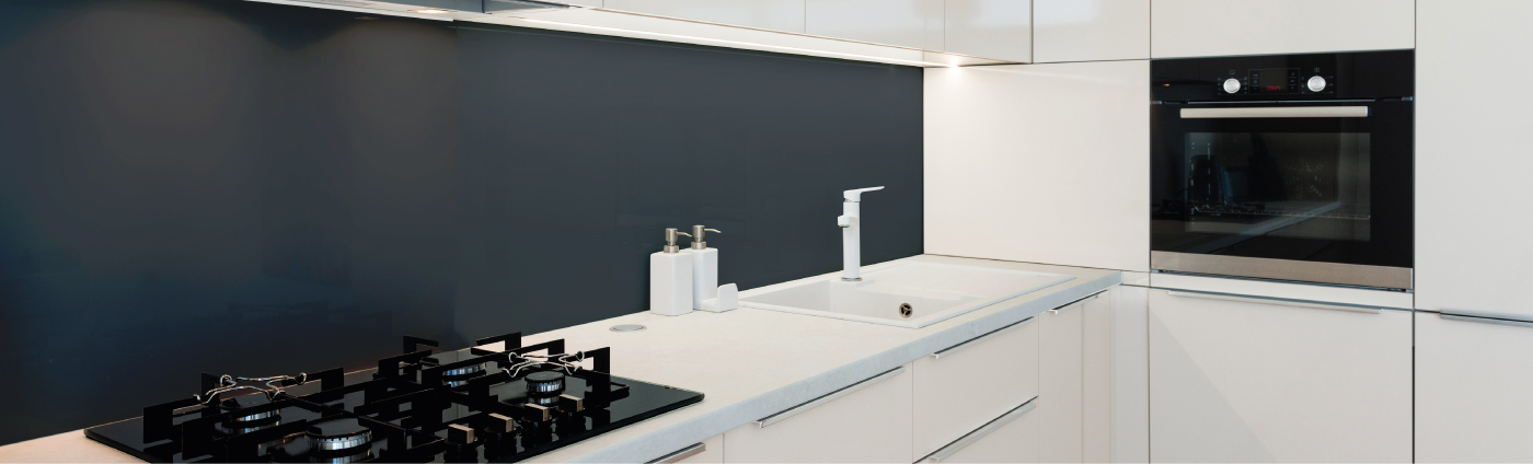 grey glass splashback in a kitchen