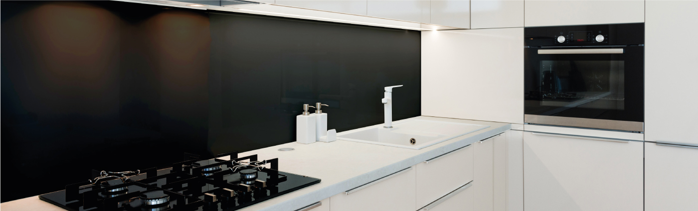 black glass splashback in a kitchen