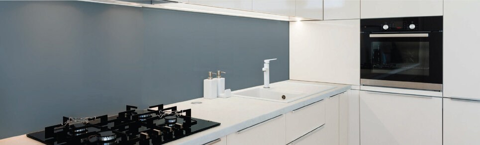 image of a kitchen scene with an anthracite grey colour glass splashback