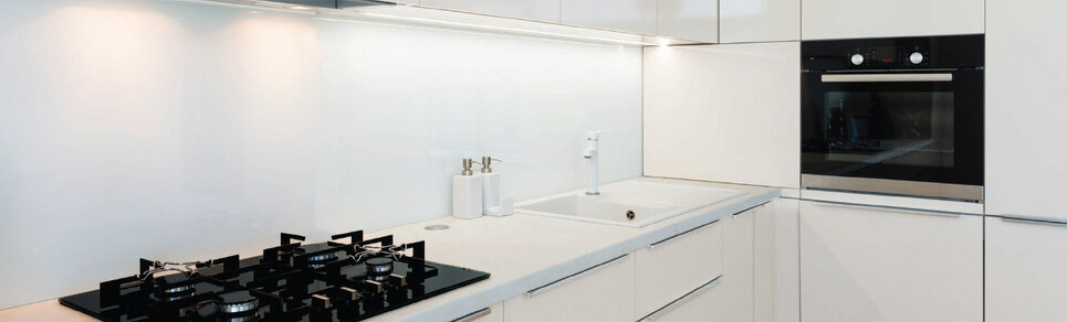 image of a kitchen scene with solid high gloss white colour glass splashback