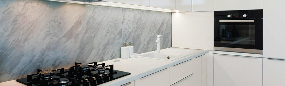 image of a kitchen scene with a marble slate effect glass splashback
